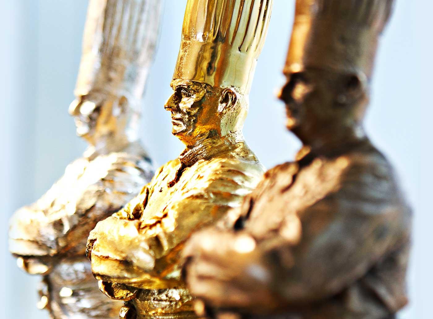 Золотая, серебряная и бронзовая статуэтки шефа Поля Бокюза. Источник http://www.russmodamag.ru/